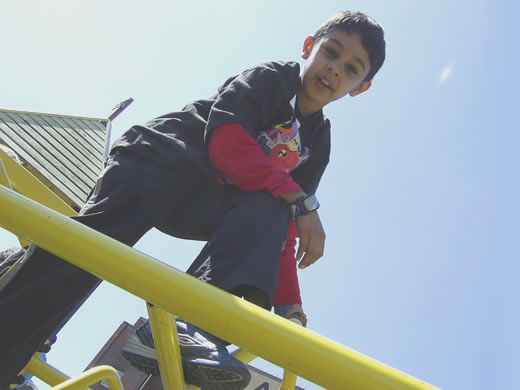 Photo of Jacari student playing on climbing frame